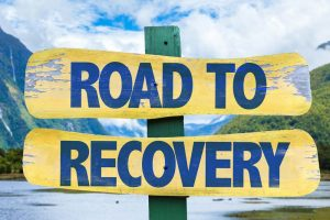 sign reading road to recovery - how to support a recovering addict - valley recovery center - sacramento california drug addiction treatment rehab center