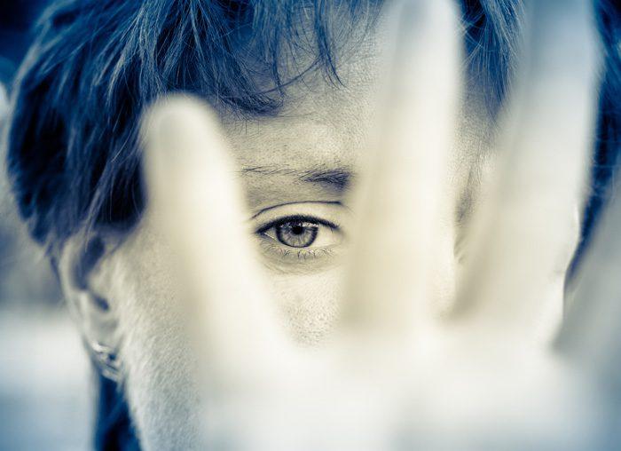 drug addiction consequences - woman hiding her face - calley recovery center
