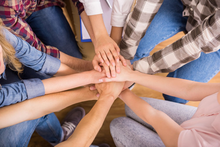 team work - hands in a pile - valley recovery center - addiction treatment center - intensive outpatient treatment for drug and alcohol addiction