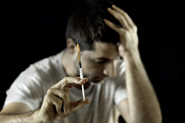 heroin overdose effects on family - man with heroin needle - valley recovery center