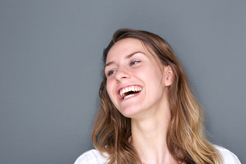 Humor-Based Therapy - young woman laughing