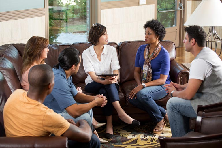 Group Therapy with a Counselor - discussion on a couch