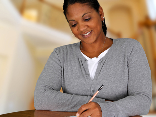 Making Realistic Goals for the New Year - woman writing