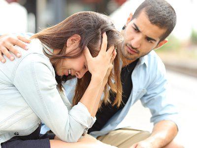man consoling woman