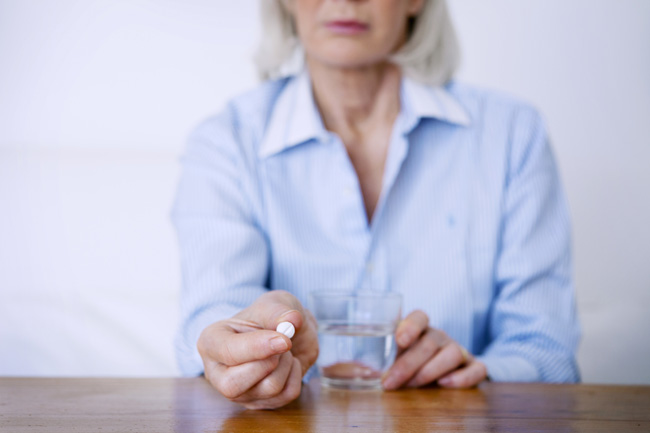 Seniors-and-Substance-Abuse--A-Growing-Problem - senior woman holding pill about to take