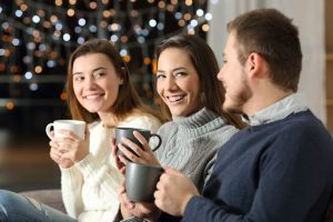 How-to-Emotionally-Prepare-for-the-Holiday-Season - friends or siblings enjoying coffee holiday time