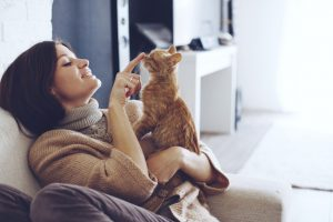 Practicing-Self-Care-When-a-Loved-One-Suffers-from-Addiction - woman with cat