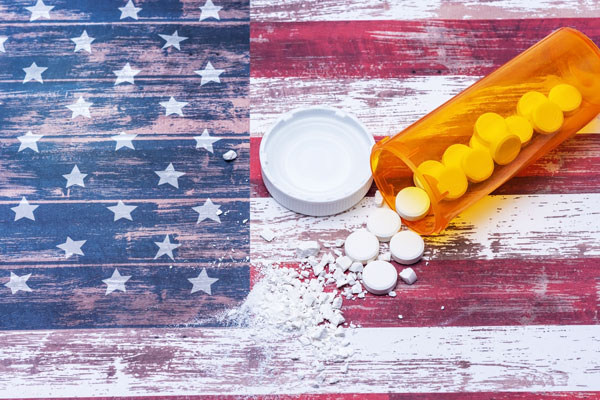 pills spilled and crushed on US flag