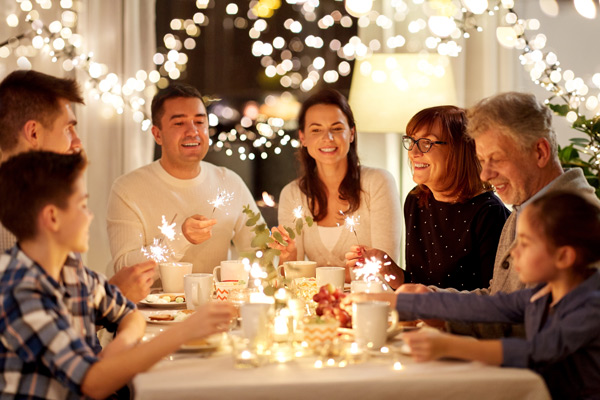 large family drinking coffee during holiday gathering - traditions